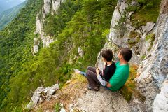 Father and son in mountains Royalty Free Stock Image