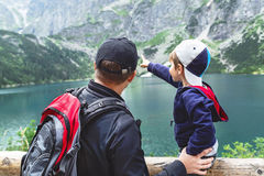 Father and son near the Eye of the Sea lake in Tatra mountains. Royalty Free Stock Photography