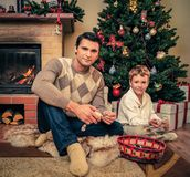Father and son near fireplace Royalty Free Stock Photography
