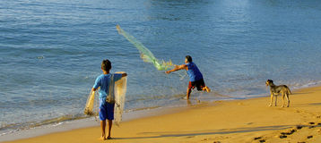 Father and son net fishing, Mexico Stock Image