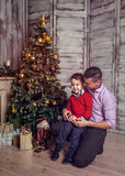 Father and the son in the new year interior Stock Image