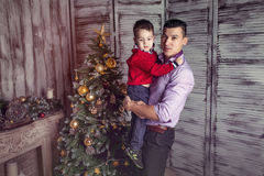 Father and the son in the new year interior Stock Images