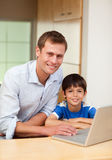 Father and son with notebook Royalty Free Stock Images