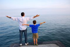 Father son ocean royalty free stock photography