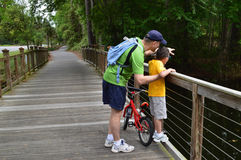 Father and son outdoor. Father and son enjoying time spent together outdoor, standing on the wooden bridge on Hilton Island, South Carolina, USA Stock Photography