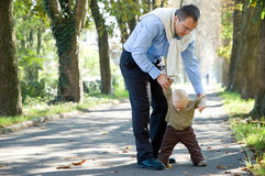 Father son outdoor park autumn Stock Photo