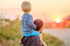 Father and son outdoor portrait in sunset sunlight Royalty Free Stock Images