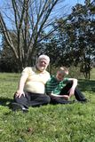 Father and Son In An Outdoor Setting Royalty Free Stock Photos