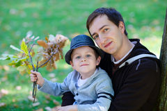 Father and son outdoors. Young family enjoying beautiful autumn day stock images