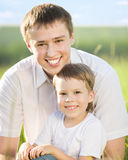 Father and son outdoors Stock Image