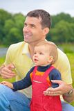 Father and son outdoors royalty free stock images