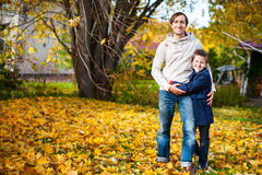 Father and son outdoors at autumn day Stock Photos