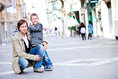 Father and son outdoors in city Stock Photography