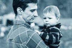 Father and son outdoors Stock Images