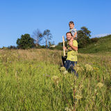 Father and son outside the home Royalty Free Stock Images