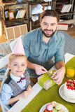 Father and son packing gift Royalty Free Stock Images