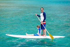 Father and son paddling Stock Photo