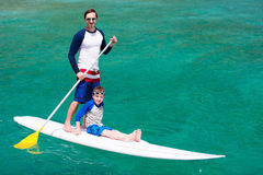 Father and son paddling Stock Image