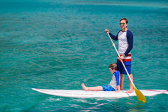Father and son paddling Royalty Free Stock Images