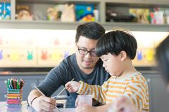 Father and son are painting. Royalty Free Stock Photo