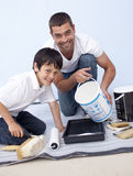 Father and son painting a room Stock Images