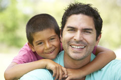 Father And Son In Park. Smiling To Camera stock photo