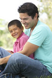 Father And Son In Park Stock Image