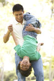 Father With Son In Park Stock Image
