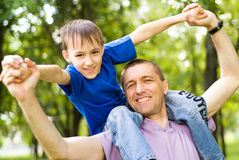 Father with son in a park Stock Photography