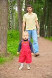 Father and son in park stock photography