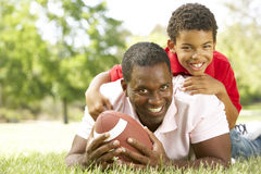 Father And Son In Park With American Football Royalty Free Stock Images