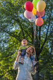 Father and son in the park with balloons Stock Photography