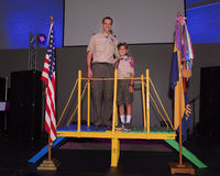 Father and son participating in scouting Stock Photo