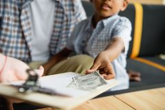 Father and son paying bill Royalty Free Stock Image