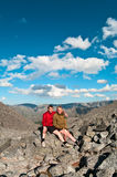 Father and son on peak. Of mountain. Two people family Royalty Free Stock Photo