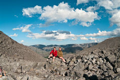 Father and son on peak. Of mountain. Two people family Royalty Free Stock Photos