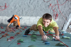Father and son perform speed climbing relay race Stock Photo