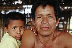 Father and son, Peruvian Amazon. A father and his son in their hut in the Peruvian Amazon royalty free stock photography