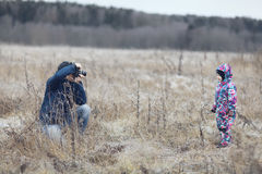 Father and son photographed in  winter field Royalty Free Stock Photography