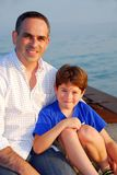 Father son pier Stock Images