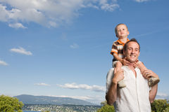 Father son piggy back Stock Photo