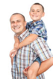 Father and son piggyback. Father giving son a piggyback ride, isolated on white background Stock Images