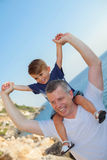 Father and son piggyback on vacation Royalty Free Stock Photography