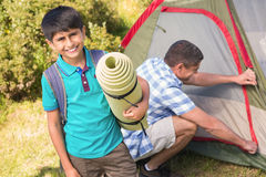 Father and son pitching their tent Stock Images