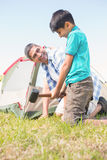 Father and son pitching their tent Royalty Free Stock Images