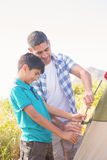 Father and son pitching their tent Royalty Free Stock Image