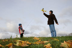 Father with son and plane Royalty Free Stock Photo
