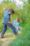 Father and son planting family tree. rich natural soil. Eco farm. Ranch. small boy child help father in farming. new stock photos