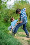 Father and son planting family tree. rich natural soil. Eco farm. Ranch. small boy child help father in farming. new. Life. soils and fertilizers. happy earth stock photo
