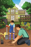 Father and son planting in the garden together Stock Images